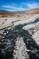 Water from nearby mountains flows into the desert floor, White Water, California, USA