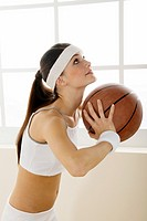 Teenage girl holding a basketball