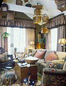 FAMILY ROOM: Cozy, floral. Olive/rose/brown drapes, furniture, valance and curtains, french doors, baskets, wod bowlf popcorn, Ralph Lauren style fabr...