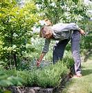 A woman in a garden, Sweden.