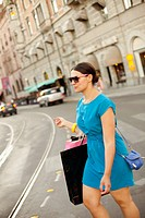 Woman walking on street with carrying shopping bags