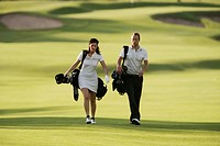 A Scandinavian man and woman playing golf, Italy.