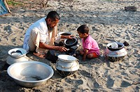 A fisherman collecting fries at Kuakata beach in Patuakhali, Bangladesh Kuakata, locally known as 'Sagar Kannya' or daughter of the sea, is one of the...