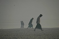 Men walking through a river bed in a winter morning, in Kushtia, Bangladesh January 4, 2008