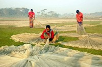 Fishermen taking care of their nets on the shore of Bay of Bengal in Dhal Char in Bhola, Bangladesh January 19, 2008