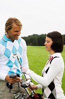 A young couple playing golf, Sweden.