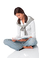 Attractive happy teenager reading book