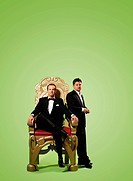 Two men by a throne.