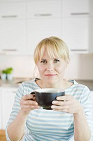 Woman having breakfast, Sweden.