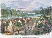 MOHAWK VILLAGE, 1780.A Mohawk Native American village in central New York, c1780. Engraving, 19th century.