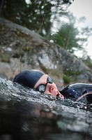 Woman swimming, close_up