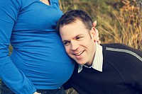 Man listening to pregnant womans stomach