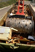 A heacy crusher is used to breakup and compact wood and paper for recycling