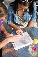 Couple sitting in cafe with map