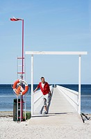 A man standing on a jetty, Malmo, Skane, Sweden.