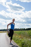 A woman doing stretching exercises, Sweden.