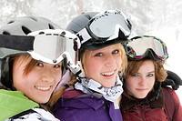 Smiling skiers hugging