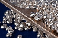 Silver Grains with a Die