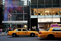 Taxis Passing By Some Designer Shops In 5Th Avenue, Midtown Manhattan, New York, USA