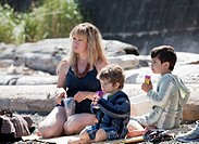 a mother having a picnic with her two sons, victoria, british columbia, canada