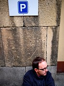 Man under parking sign