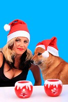 Female santa claus with her little helper dog
