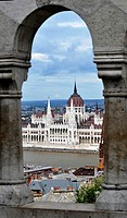 Budapest Parliament through arch of Fisherman Bastion, Budapest, Hungary, Central Europe