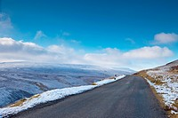 road through snowy landscape, yorkshire dales, england
