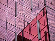 Pink reflections on a glass skyscraper