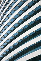 Parallel curved balconies on the front of a hotel
