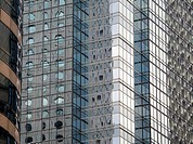 Patterns formed by reflections on a glass skyscraper
