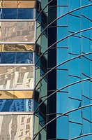 Reflections in a modern mirrored skyscraper