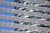 Reflections in a mirrored skyscraper