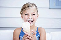 Laughing girl with ice cream on her face