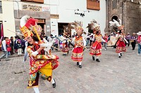 Traditional dancers participating in a street festival in Cusco, Peru