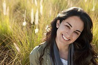 Smiling young woman in a field
