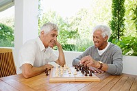 Pair of senior men playing chess