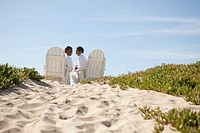 Couple in bathrobes relaxing on beach