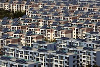 Rows of residential houses with solar panels on top
