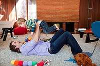 Father lifting son in living room (thumbnail)