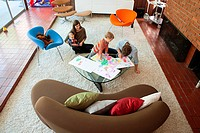 Family playing in living room (thumbnail)