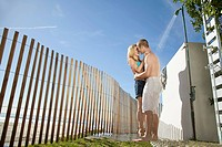 Couple kissing under outdoor shower