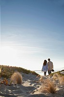 Young couple walking in bright sunshine (thumbnail)