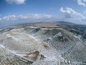 Aerial photograph of the snowy hills of Judea