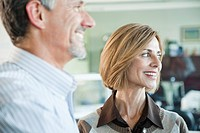 Man and woman smiling in office