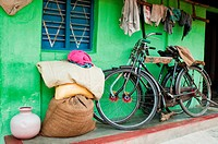 Bicycles and hessian sacks and rags outside village house near Mysore, Karnataka (thumbnail)