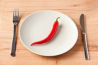 red chili pepper on plate