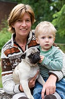 Woman with child and pug