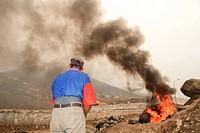 Burnuing tyres at a slum