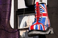England, London, Camden. A large model of a Union Jack Dr Martens boot above a shop in Camden High Street